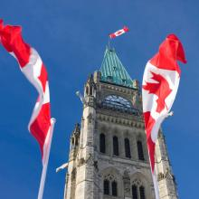 Canadian flags and Parliament